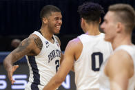 CORRECTS TO MYLES DREAD, INSTEAD OF JAMARI WHEELER - Penn State guard Myles Dread (2) celebrates with guard Myreon Jones (0) after scoring a buzzer-beater 3-point shot against Minnesota during an NCAA college basketball game Wednesday, March 3, 2021, in State College, Pa. (Noah Riffe/Centre Daily Times via AP)