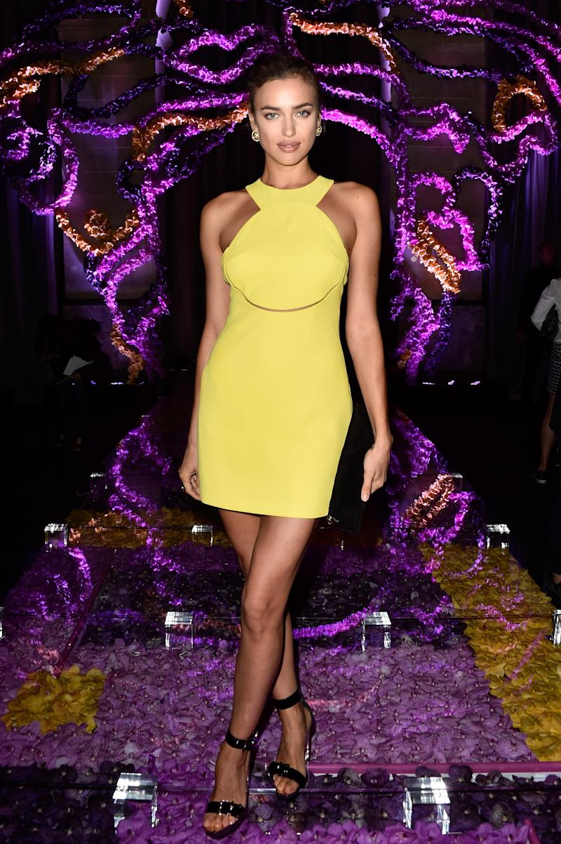 Shayk took in the Atelier Versace Fall/Winter 2015 Haute Couture show from the front row in a yellow dress by the brand.