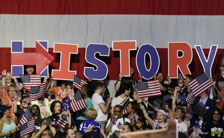 """Supporters for Hillary Clinton spell the word """"History"""" during a primary night rally on Tuesday in New York. (Photo: Julie Jacobson/AP)"""