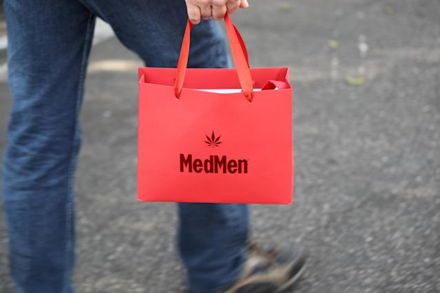 <p>A customer walks out of the MedMen store with recreational marijuana in West Hollywood, Calif., Jan. 2, 2018. (Photo: Lucy Nicholson/Reuters) </p>