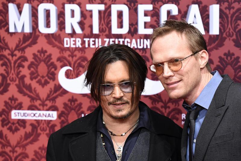 Johnny Depp and Paul Bettany in 2015 (AFP via Getty Images)