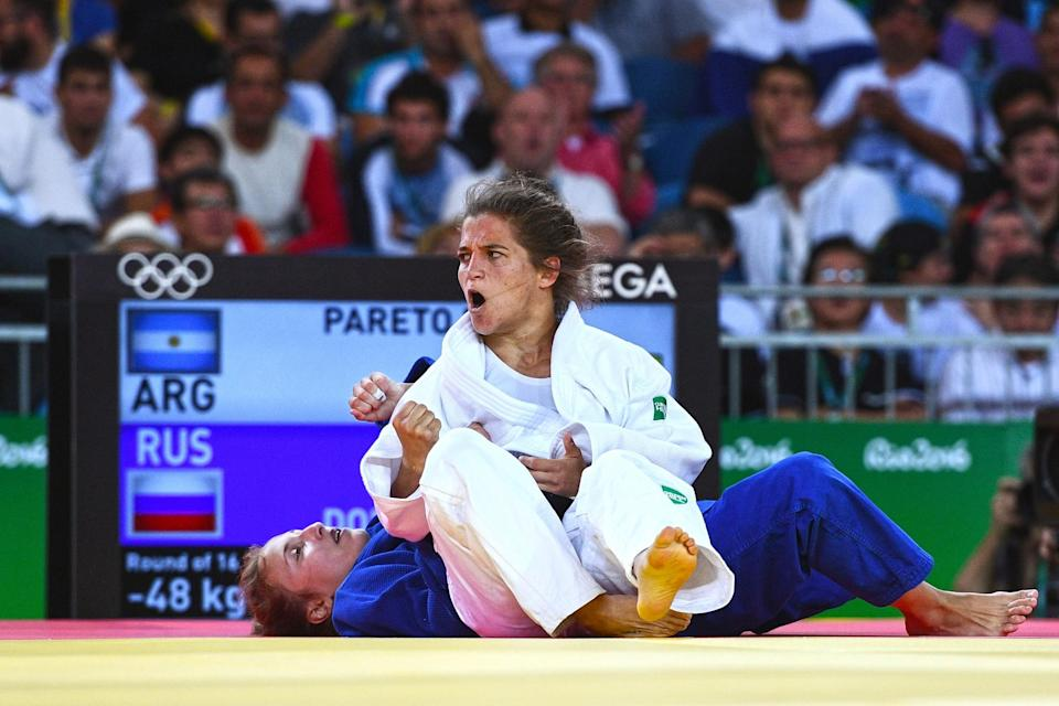 <p>Paula Pareto of Argentina (white) competes against Irina Dolgova of Russia in the Women's -48 kg Judo on Day 1 of the Rio 2016 Olympic Games at Carioca Arena 2 on August 6, 2016 in Rio de Janeiro, Brazil. (Photo by David Ramos/Getty Images) </p>