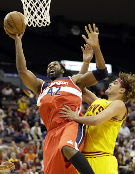 Washington Wizards center Nene (42), of Brazil, shoots against Cleveland Cavaliers forward Anderson Varejao, also of Brazil, in the first half of an NBA preseason basketball game on Wednesday, Oct. 23, 2013, in Cincinnati. (AP Photo/Al Behrman)