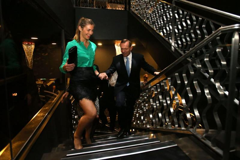 Tony Abbott's daughter Frances has been recording her fitness progress for an upcoming bikini modelling competition. The pair are pictured here together in 2013. Source: Getty