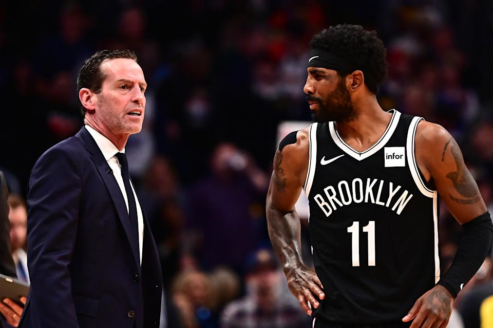 Nov 14, 2019; Denver, CO, USA; Brooklyn Net head coach Kenny Atkinson and guard Kyrie Irving (11) talk in the fourth quarter against the Denver Nuggets at the Pepsi Center. Mandatory Credit: Ron Chenoy-USA TODAY Sports
