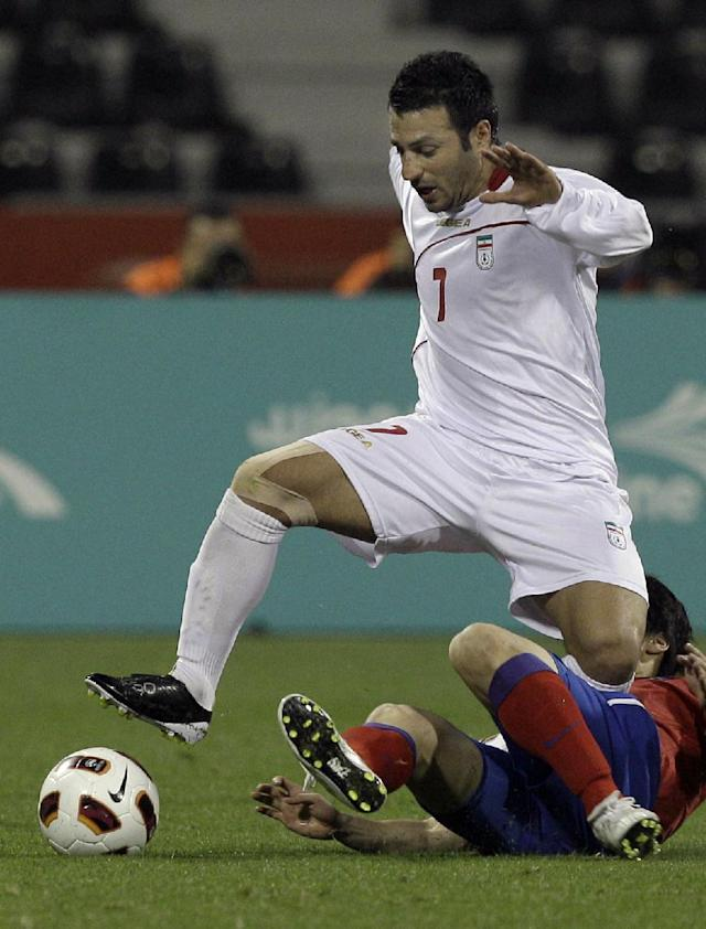 FILE - In this Iran's Jan. 22, 2011, file photo, player Gholam Reza Rezaei holds the ball during his AFC Asian Cup Quarter Finals soccer match against South Korea at Qatar Sports Club Stadium, in Doha, Qatar. (AP Photo/Kin Cheung, File)