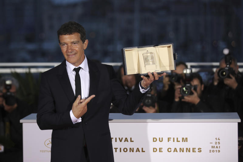 Actor Antonio Banderas poses with the best actor Palme d'Or award for the film 'Pain and Glory' during a photo call following the awards ceremony at the 72nd international film festival, Cannes, southern France, Saturday, May 25, 2019. (AP Photo/Petros Giannakouris)