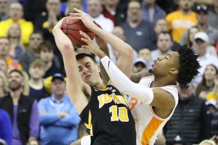 Mar 24, 2019; Columbus, OH, USA; Iowa Hawkeyes guard Joe Wieskamp (10) and Tennessee Volunteers guard Jordan Bowden (23) battle for the ball in the second half in the second round of the 2019 NCAA Tournament at Nationwide Arena. Mandatory Credit: Kevin Jairaj-USA TODAY Sports
