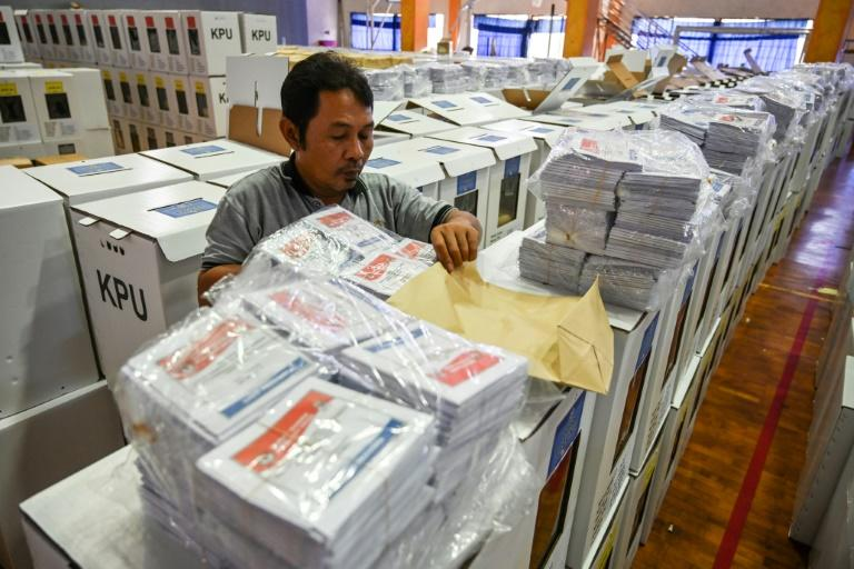 An official prepares ballot boxes and other voting materials in Jakarta ahead of elections next week. Indonesia  is investigating vote-rigging claims after thousands of ballot papers were disovered in neighbouring Malaysia
