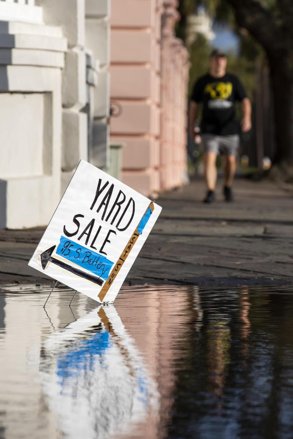 A yard sale sign reflects in flood waters as a king tide rolls into the Battery in Charleston, S.C. Sunday, Nov. 15, 2020. Charleston has remained relatively unscathed this hurricane season. That means more time to mull a $1.75 billion proposal by the Army Corps of Engineers that features a sea wall along the city's peninsula to protect it from deadly storm surge during hurricanes. (AP Photo/Mic Smith)