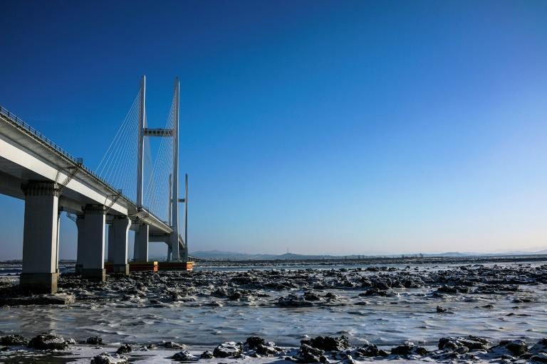 A four-lane, $350 million bridge with a new customs zone is seen over the Yalu river between the North Korean town of Sinuiju and Dandong in China's northeast Liaoning province
