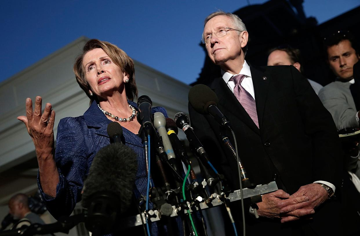 U.S. House Minority Leader Rep. Nancy Pelosi (D-CA) (L) and U.S. Senate Majority Leader Sen. Harry Reid (D-NV) (R) speak to the media with after a meeting at the White House with U.S. President Barack Obama, Speaker of the House John Boehner and Senate Minority Leader Mitch McConnell about the government shutdown on October 2, 2013 in Washington, D.C. (Photo by Win McNamee/Getty Images)