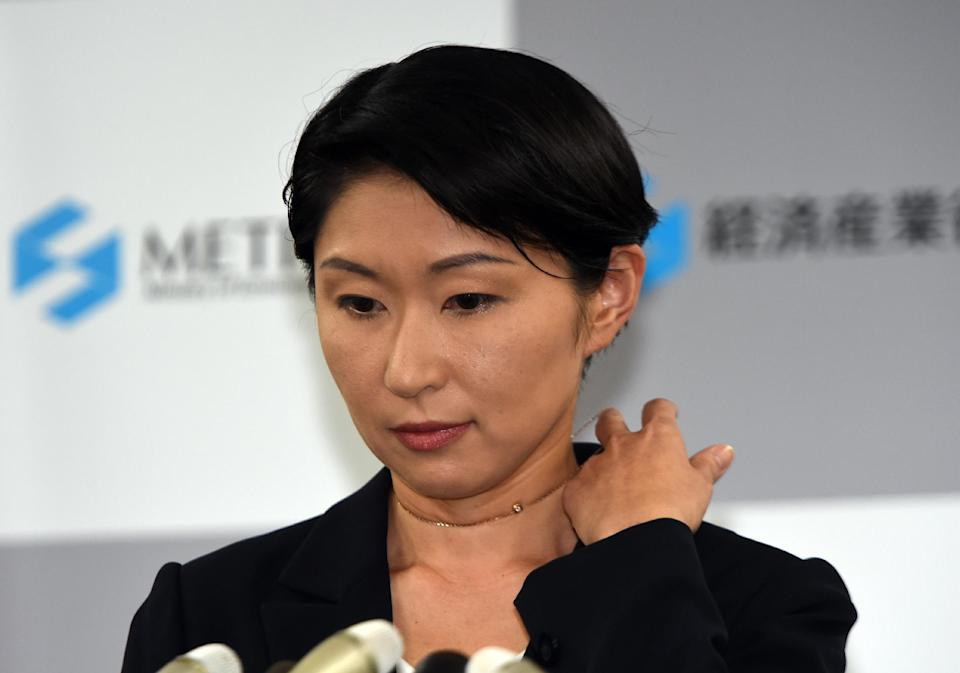 Japanese industry minister Yuko Obuchi announces her resignation in Tokyo on October 20, 2014. The scanadal is a blow to Prime Minister Shinzo Abe's gender reform drive (AFP Photo/Yoshikazu Tsuno)