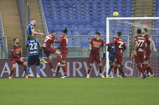 Inter Milan's Milan Skriniar, top left, scores his side's first goal during a Serie A soccer match between Roma and Inter Milan at Rome's Olympic stadium, Sunday, Jan. 10, 2021. (AP Photo/Gregorio Borgia)