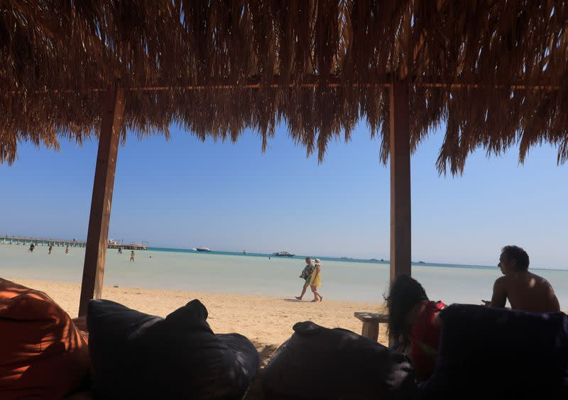 Tourists enjoy their summer vacation on a beach at a Red Sea resort, amid the coronavirus disease (COVID-19) outbreak, in Hurghada