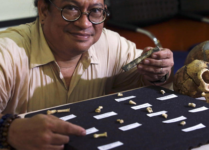 Filipino archeologist Armand Salvador Mijares shows bones and teeth they recovered from Callao Cave belonging to a new specie they called Homo luzonensis during a press conference in metropolitan Manila, Philippines on Thursday, April 11, 2019. Fossil bones and teeth found in Cagayan province, northern Philippines, have revealed a long-lost cousin of modern people, which evidently lived around the time our own species was spreading to Africa to occupy the rest of the world. (AP Photo/Aaron Favila)