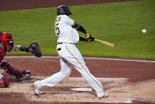 Pittsburgh Pirates' Gregory Polanco hits a three-run home run off St. Louis Cardinals relief pitcher Austin Gomber during the fourth inning of a baseball game in Pittsburgh, Thursday, Sept. 17, 2020. (AP Photo/Gene J. Puskar)