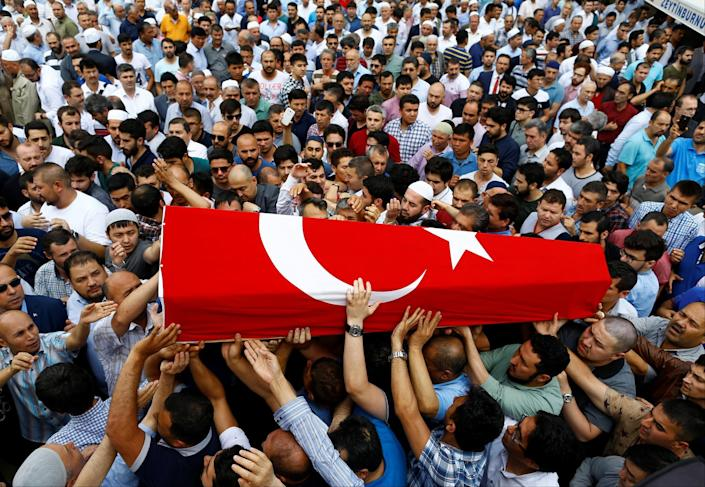 <p>Friends and relatives of Habibullah Sefer, who was killed in Tuesday's attack at Istanbul airport, carry his flag-draped coffin during his funeral ceremony in Istanbul, Turkey, June 30, 2016. (REUTERS/Osman Orsal) </p>