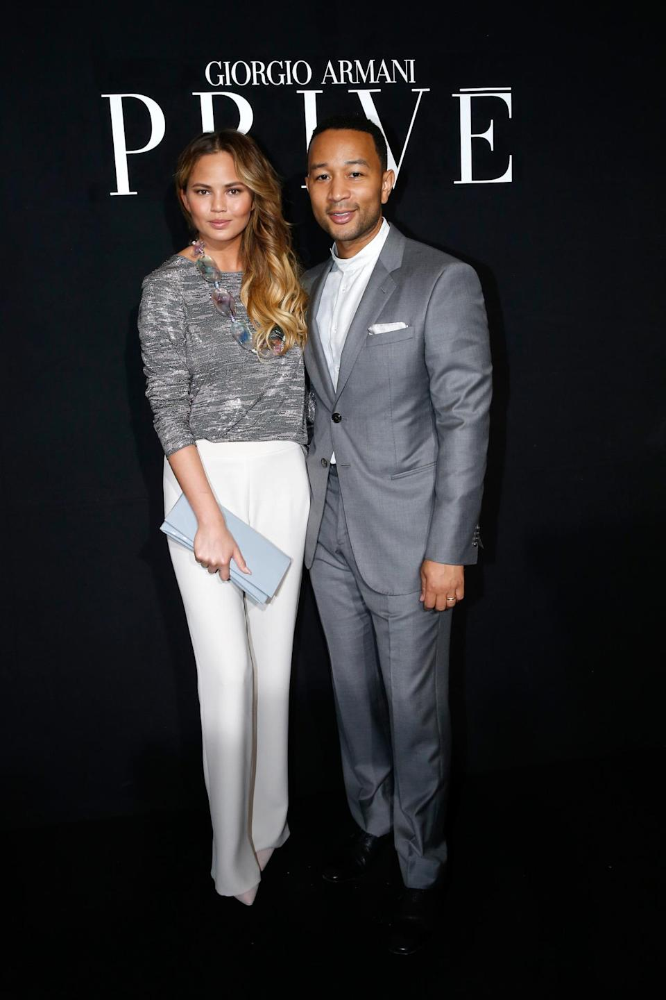 <p>As saying goes, a couple that dresses together stays together, and clearly that's what both Chrissy and John were thinking when they arrived to the Armani Privé in a similar color palette.</p>