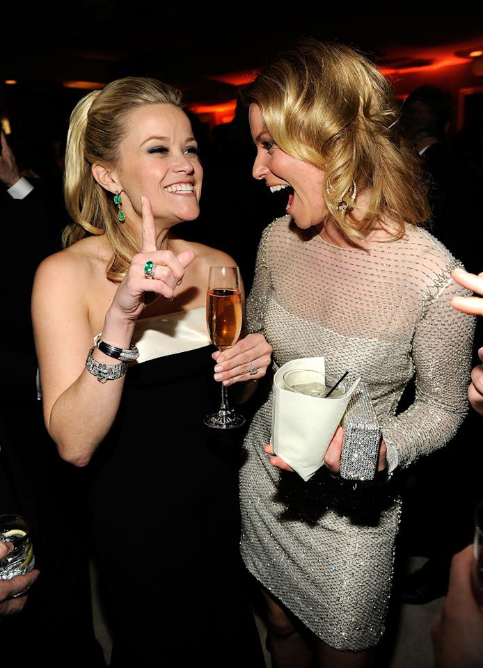 Reese Witherspoon (in Giorgio Armani) giggled the night away with fellow blond Elizabeth Banks.