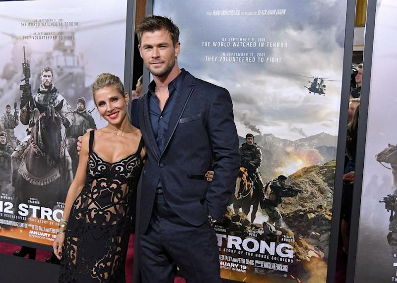 Actors Elsa Pataky (L) and Chris Hemsworth attend the