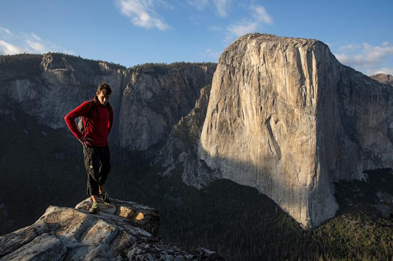Alex Honnold atop Lower Cathedral with El Capitan in the background at Yosemite National Park in California.