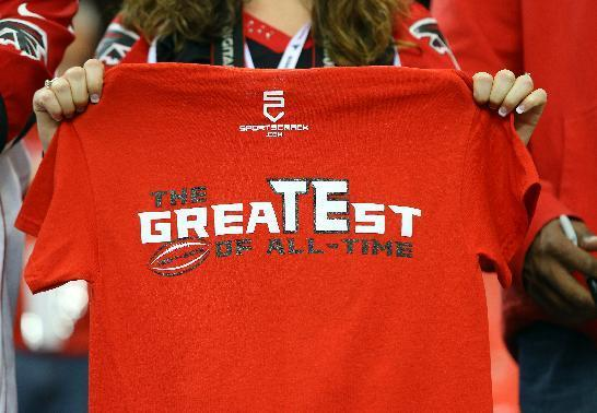 Sidney Sears, of Gainesville, Fla., holds out the back of her shirt in support of Atlanta Falcons tight end Tony Gonzalez before an NFL football game between the Falcons and Carolina Panthers on Sunday, Dec. 29, 2013, in Atlanta. (AP Photo/Atlanta Journal-Constitution, Curtis Compton)