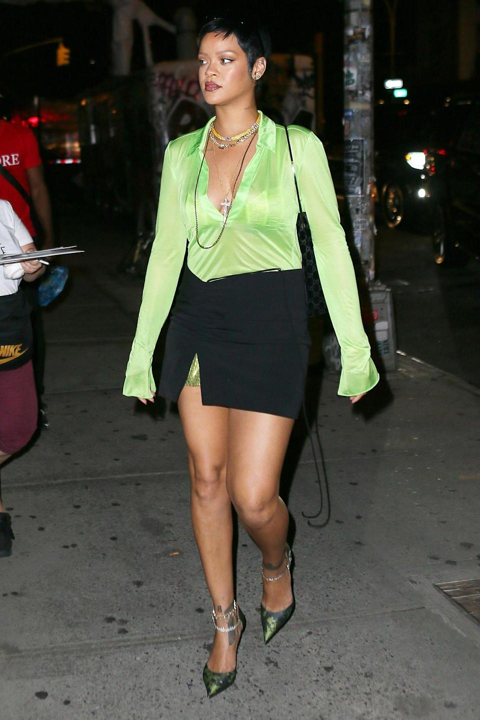 <p>Rihanna looks stunning in a lime green top and black skirt outside of The Bowery Hotel in N.Y.C. on June 28.</p>