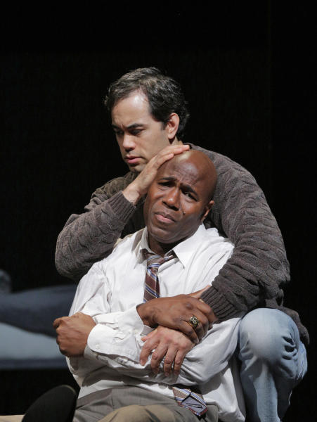 "This undated image released by the Opera Theatre of Saint Louis shows Arthur Woodley as Emile Griffith, foreground, and Brian Arreola as Luis Rodrigo Griffith in Opera Theatre of Saint Louis' 2013 world premiere production of ""Champion,"" by Jazz composer Terence Blanchard. Blanchard's ""Champion"" _ with a libretto by Pulitzer Prize-winning playwright Michael Cristofer _ is based on the life of former world welterweight and middleweight champion Emile Griffith. Its world premiere comes at the Opera Theatre of St. Louis on Saturday, June 15. (AP Photo/Opera Theatre of Saint Louis, Ken Howard)"