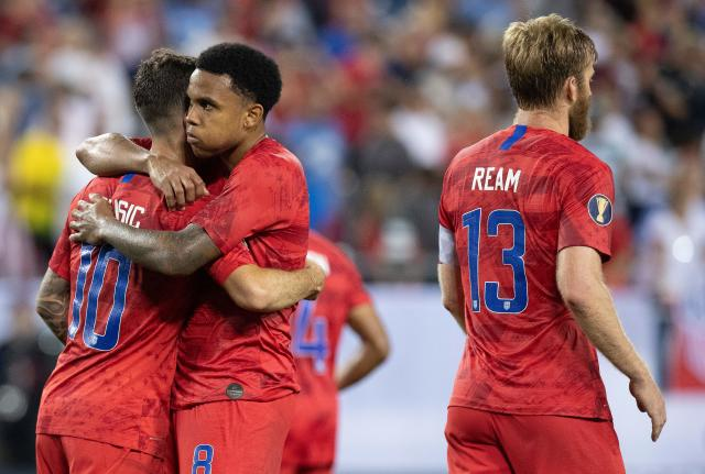 Christian Pulisic and Weston McKennie embrace after a 2019 Gold Cup semifinal victory over Jamaica. (Getty)