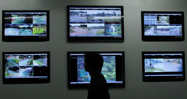 Closed-circuit television (CCTV) camera monitors are installed at the command center of the National Parks Development Committee (NPDC) in Manila, Nov. 27, 2012. The project is part of efforts to protect tourists and visitors at the park from criminal elements. (Paulo Vecina, NPPA Images)