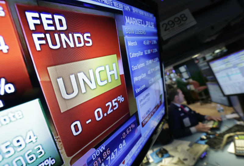 Fed keeps stimulus, says taxes and cuts have hurt