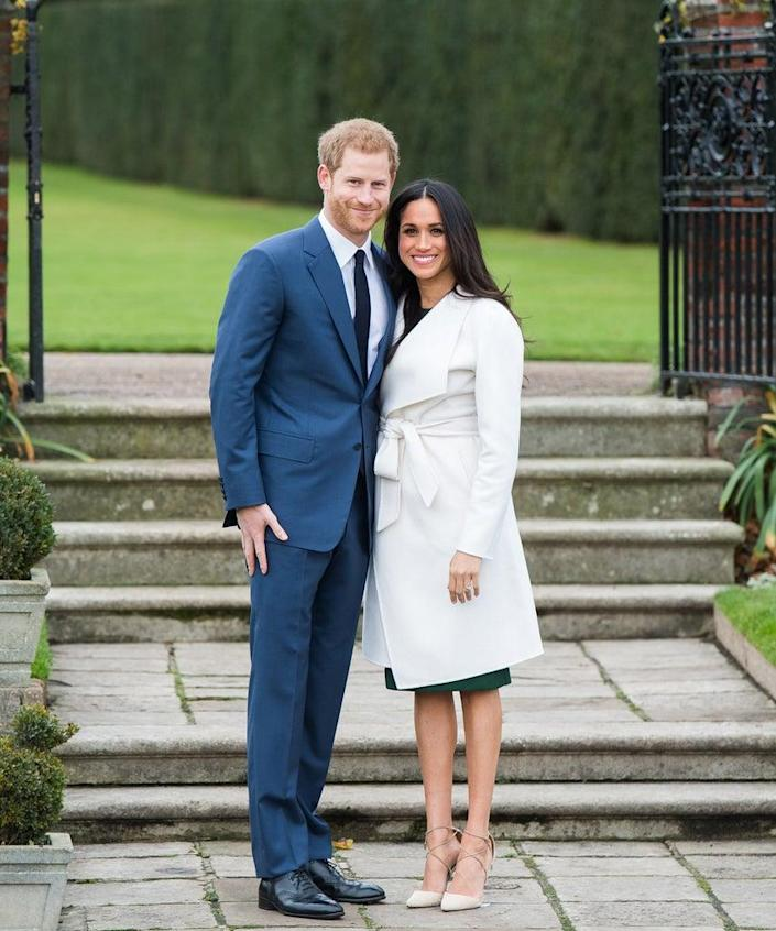 LONDON, ENGLAND – NOVEMBER 27: Prince Harry and Meghan Markle during an official photocall to announce the engagement of Prince Harry and actress Meghan Markle at The Sunken Gardens at Kensington Palace on November 27, 2017 in London, England. Prince Harry and Meghan Markle have been a couple officially since November 2016 and are due to marry in Spring 2018. (Photo by Samir Hussein/Samir Hussein/WireImage)
