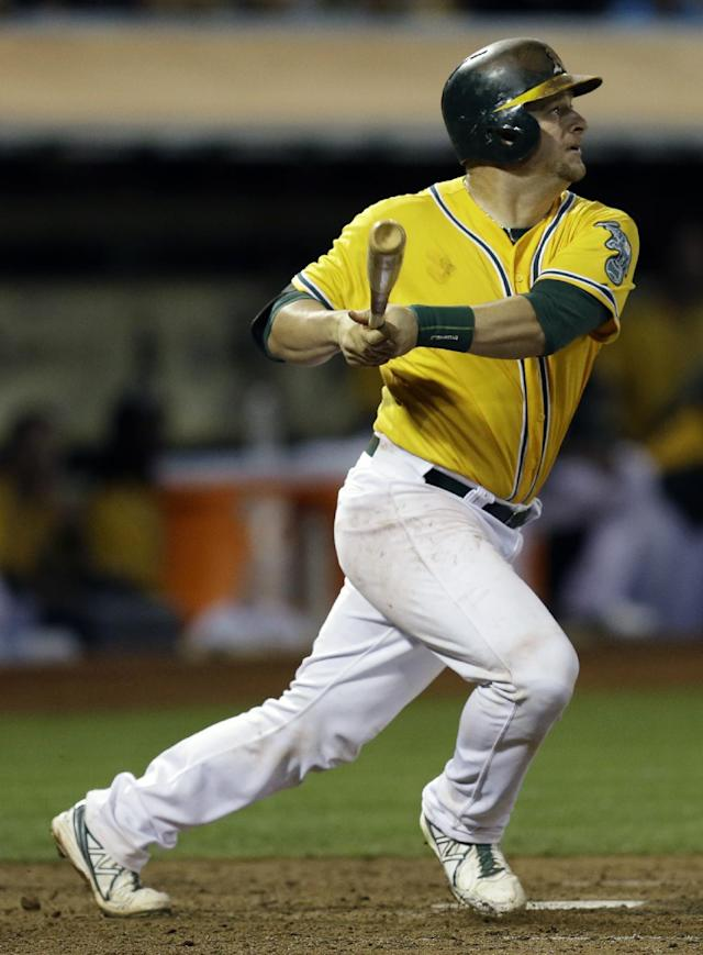 Oakland Athletics' Stephen Vogt swings for an RBI double off Houston Astros' Brad Peacock in the eighth inning of a baseball game Thursday, Sept. 5, 2013, in Oakland, Calif. (AP Photo/Ben Margot)