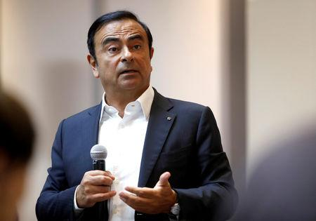 FILE PHOTO:Carlos Ghosn, chairman and CEO of the Renault-Nissan-Mitsubishi Alliance, responds to a question on the alliance's new venture capital fund during roundtable with journalists at the 2018 CES in Las Vegas