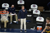 FILE - In this Dec. 2, 2020, file photo, Gonzaga coach Mark Few watches during the first half of the team's NCAA college basketball game against West Virginia in Indianapolis. Coach Few of top-ranked Gonzaga says the suspension of basketball activities for the past two weeks because of the coronavirus pandemic has ''not helped us in any way, shape or form. Few called it the biggest challenge he had faced as a head coach during a Zoom call Thursday, Dec. 17, 2020, as the Bulldogs prepared to face No. 3 Iowa on Saturday in South Dakota. (AP Photo/Darron Cummings, File)