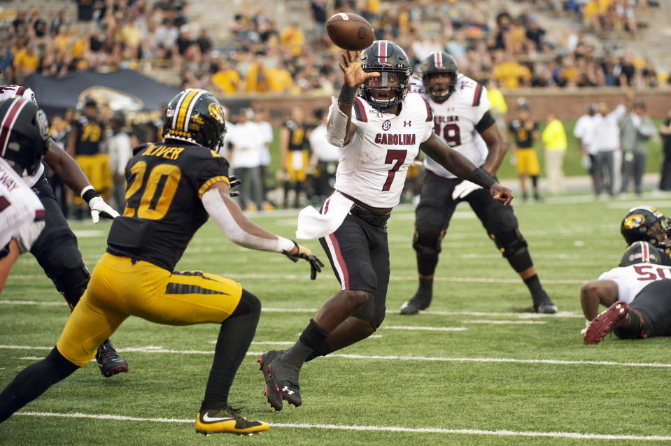 South Carolina quarterback Dakereon Joyner, right, tosses a pass over Missouri defensive back Khalil Oliver, left, during the fourth quarter of an NCAA college football game Saturday, Sept. 21, 2019, in Columbia, Mo. Missouri won the game 34-14. (AP Photo/L.G. Patterson)