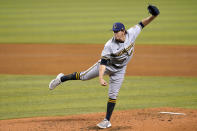 Milwaukee Brewers relief pitcher Patrick Weigel follows through on a delivery during the third inning of a baseball game, Friday, May 7, 2021, in Miami. (AP Photo/Lynne Sladky)