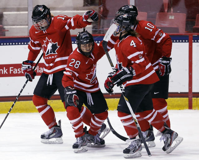 Canada's Vicki Bendus (28) celebrates her goal against Finland with teammates Courtney Birchard (11), Gillian Apps (10) and Brigette Lacquette (4) during the first period of a Four Nations Cup women's championship hockey game on Saturday, Nov. 9, 2013, in Lake Placid, N.Y. (AP Photo/Mike Groll)