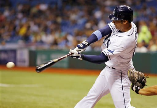 Tampa Bay Rays Carlos Pena hits the ball against Oakland Athletics pitcher Bartolo Colon during of a baseball game, Saturday, May 5, 2012, in St. Petersburg, Fla. (AP Photo/Scott Iskowitz)