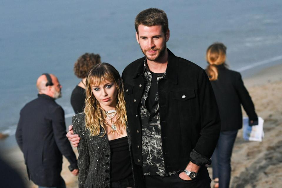 """<p>Liam and Miley are a real roller-coaster couple if there's ever been one. They met when they filmed the 2009 movie <em>The Last Song</em> and made their red-carpet debut in 2010. They confirmed their engagement in June 2012, and by September 2013, they called things off. They got married in December 2018, and by August 2019, <a href=""""https://www.elle.com/culture/celebrities/a29372528/miley-cyrus-on-dating-criticism-liam-hemsworth-split/"""" rel=""""nofollow noopener"""" target=""""_blank"""" data-ylk=""""slk:they had split again"""" class=""""link rapid-noclick-resp"""">they had split again</a>. Their divorce <a href=""""http://www.elle.com/culture/celebrities/a30692789/miley-cyrus-liam-hemsworth-divorce-finalized/"""" rel=""""nofollow noopener"""" target=""""_blank"""" data-ylk=""""slk:was finalized"""" class=""""link rapid-noclick-resp"""">was finalized</a> in January 2020.</p>"""