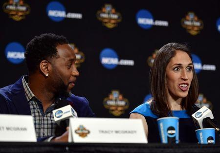 Apr 1, 2017; Glendale, AZ, USA; WNBA former player Rebecca Lobo speaks are NBA former player Tracy McGrady listens during the Naismith Hall of Game Press Conference at University of Phoenix Stadium. Mandatory Credit: Joe Camporeale-USA TODAY Sports