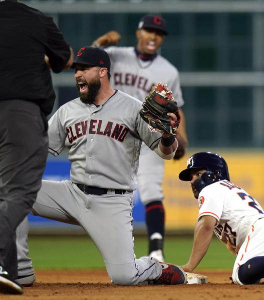 Cleveland Indians' Jason Kipnis, left, reacts after tagging Houston Astros' Jose Altuve, right, out as he tried to steal second base during the eighth inning of a baseball game Thursday, April 25, 2019, in Houston. (AP Photo/David J. Phillip)