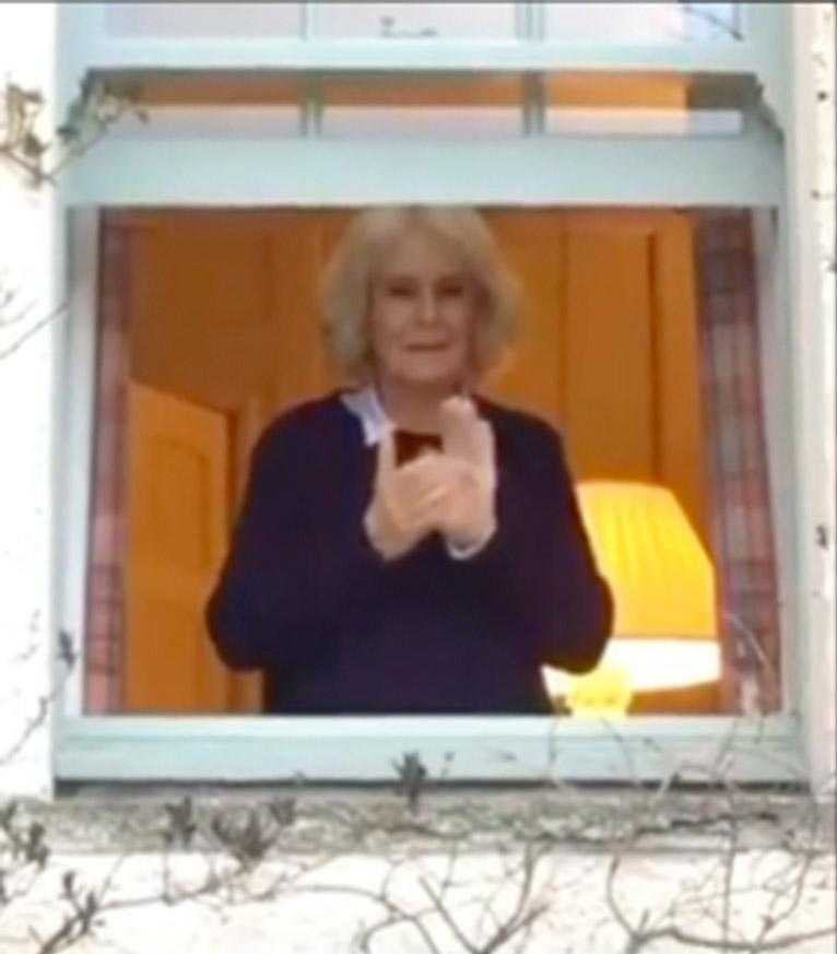 Camilla 'claps for carers' from the window at Birkhall, Scotland, where she remains in self-isolation after Charles' COVID-19 diagnosis. Photo: Instagram/clarencehouse.