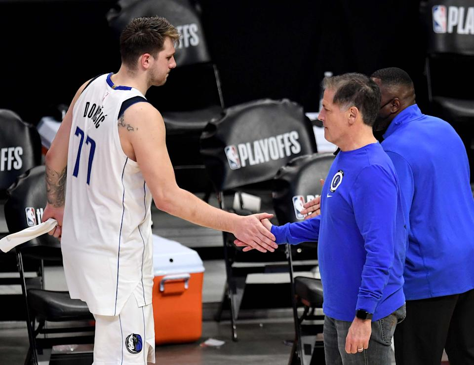 Los Angeles, CA - June 06:  Dallas Mavericks owner Mark Cuban shakes hands with Luka Doncic #77 of the Dallas Mavericks after defeating the Dallas Mavericks 126-111 during game seven of the Western Conference First Round NBA Playoff basketball game at the Staples Center in Los Angeles on Sunday, June 6, 2021. LA Clippers won 126-111 to advance to the second round. (Photo by Keith Birmingham/MediaNews Group/Pasadena Star-News via Getty Images)