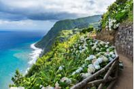 """<p>The Azores are a magical archipelago in the mid-Atlantic and part of Portugal. Dramatic landscapes filled with massive cliffs emerging from hypnotizing waters, endless hedgerows of blue hydrangea, an abundance of wildlife, and beautiful waterfalls, this secluded stretch of islands is a must-visit. </p><p>Find a romantic getaway in <a href=""""https://www.whiteazores.com/"""" rel=""""nofollow noopener"""" target=""""_blank"""" data-ylk=""""slk:White"""" class=""""link rapid-noclick-resp"""">White</a>, an oceanfront hotel that offers an array of amenities and Mediterranean-chic digs. </p>"""