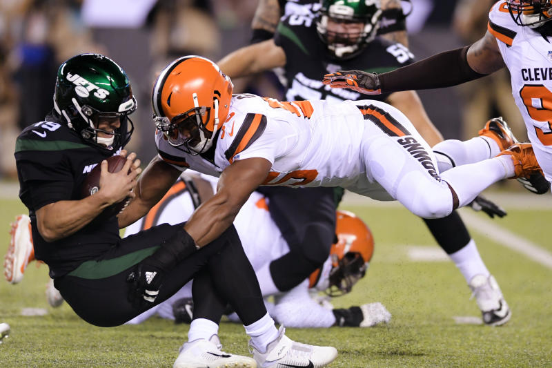 FILE - In this Sept. 16, 2019, file photo, Cleveland Browns' Myles Garrett (95) sacks New York Jets' Trevor Siemian (19) during the first half of an NFL football game in East Rutherford, N.J. Garrett leads the league with five sacks in two games. (AP Photo/Bill Kostroun, File)