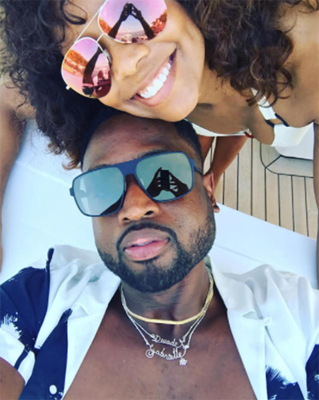 "<p>Notice Wade's necklaces, which spell out both their names. ""Lovers lane,"" he wrote. (Photo:<a href=""https://www.instagram.com/p/BV2bhlHgc4_/?taken-by=dwyanewade&hl=en"" rel=""nofollow noopener"" target=""_blank"" data-ylk=""slk:Dwyane Wade via Instagram"" class=""link rapid-noclick-resp""> Dwyane Wade via Instagram</a>) </p>"