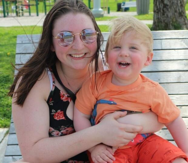 Christine Hurley and 19-month-old son Theo enjoying the nice weather by Cobbs Pond, Gander.  (Garrett Barry/CBC - image credit)