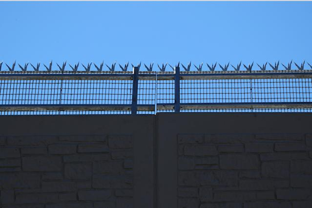 <p>The top of one of President Donald Trump's eight border wall prototypes is pictured along U.S.- Mexico border near San Diego, Calif., Oct. 23, 2017. (Photo: Mike Blake/Reuters) </p>